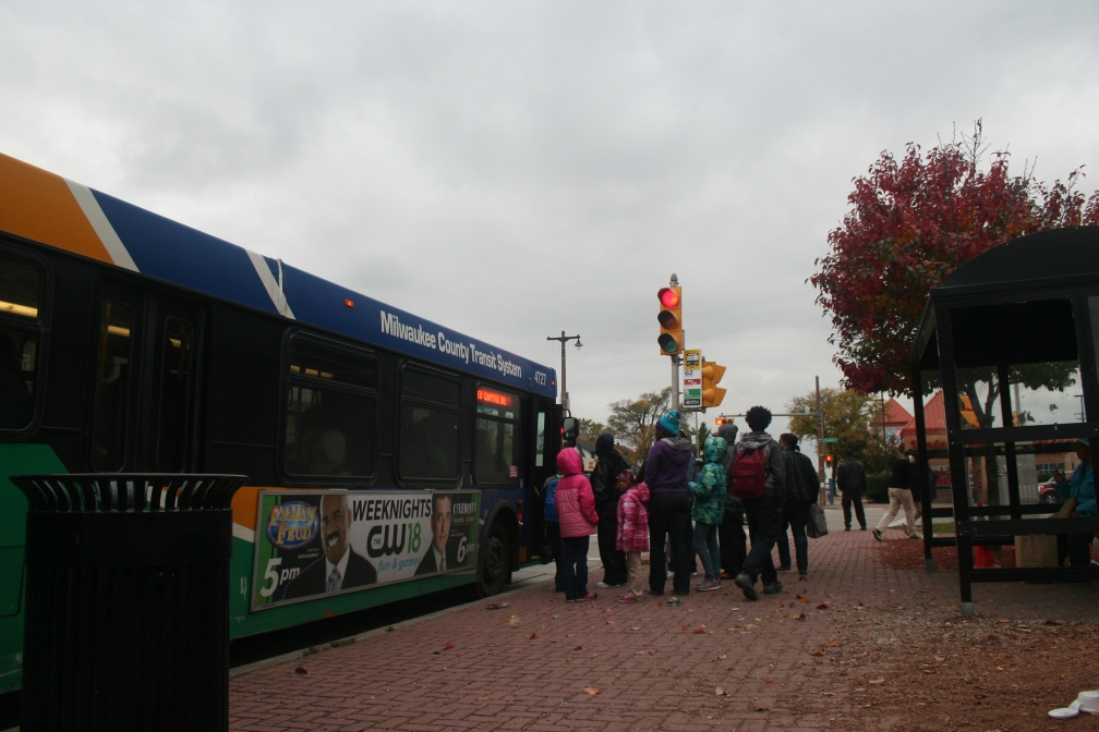 Milwaukee residents board a bus at the intersection of Teutonia and Capitol on the city's northwest side.