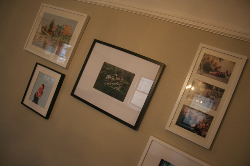 A collage of photos on a dining room wall in the Marshall home.