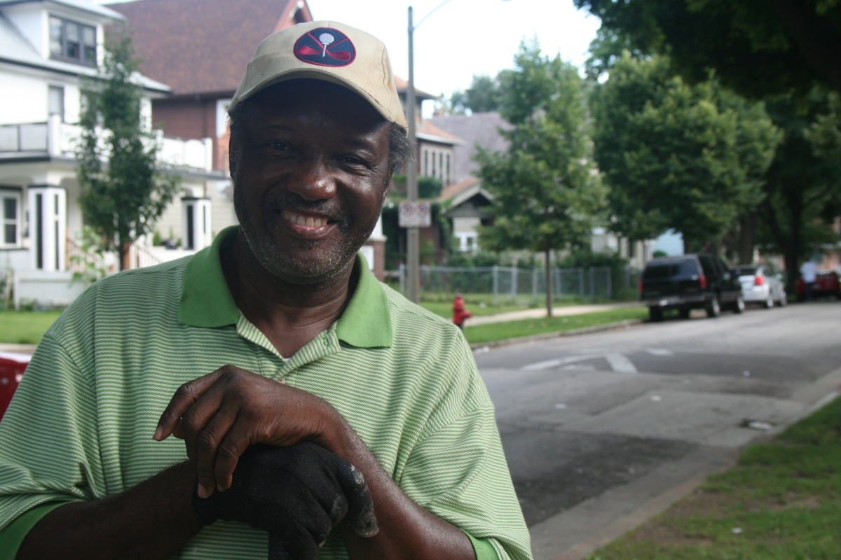 Lonnie Hughes stands in front of his home in Milwaukee's Sherman Park neighborhood. (Photo by Jabril Faraj)