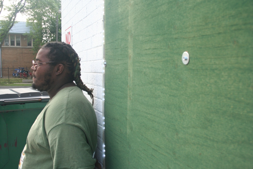 Marion Long leans against the corner store near his home in Sunset Heights. (Photo by Jabril Faraj)