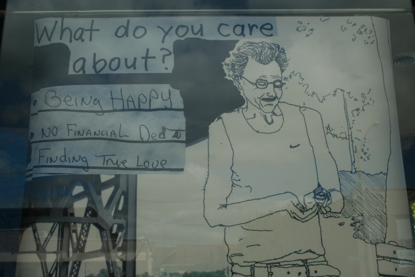 A drawing by Sarah Gail Luther, displayed in a window near S. 33rd St. and W. National Ave. (Photo by Jabril Faraj)