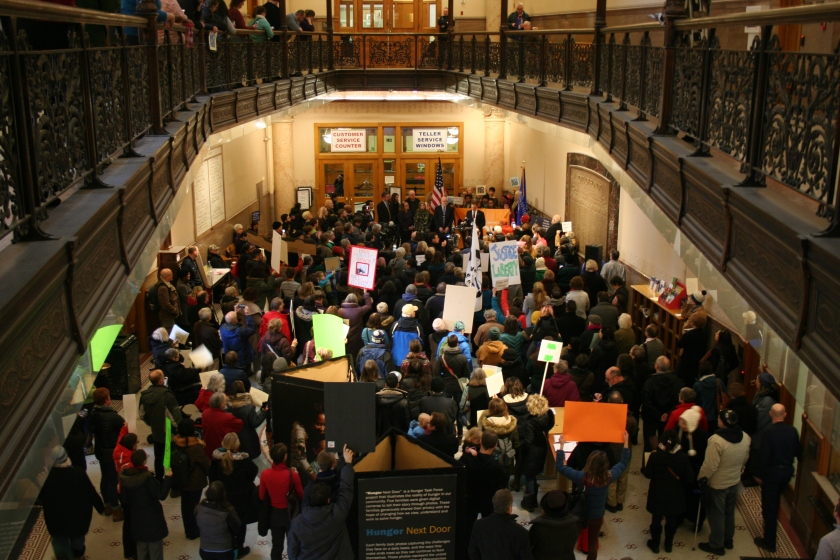 Demonstrators at Milwaukee City Hall held signs, and spoke against, an executive action that banned green card holders, immigrants and refugees from Muslim-majority countries. (Photo by Jabril Faraj)